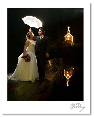 roche harbor winter wedding picture inspiration at night with backlit umbrella photographer
