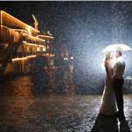 hotel haro night wedding photo in rain and umbrella