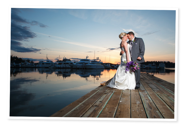 sunset wedding pictures at roche harbor with boats in background