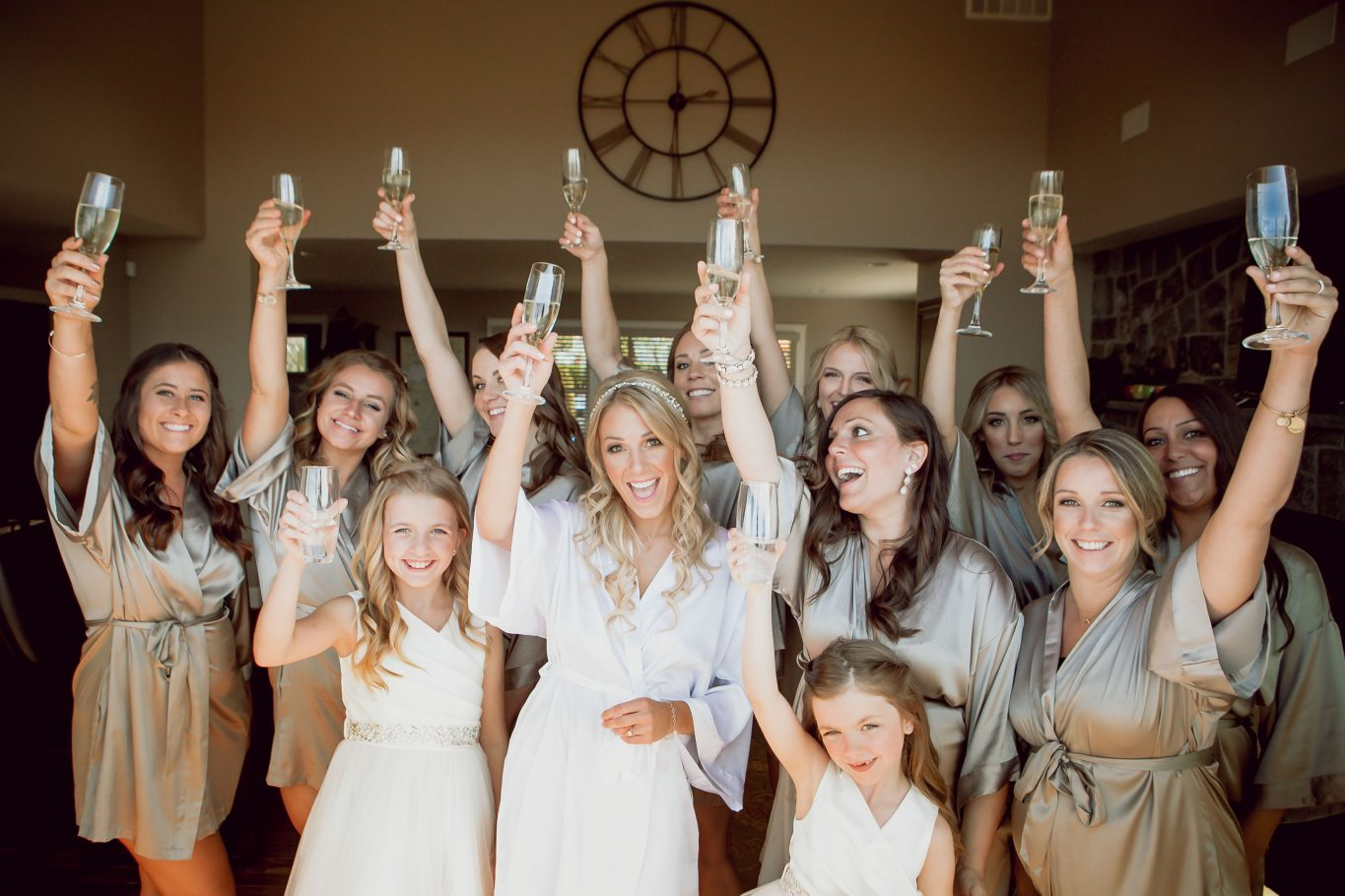 bridesmaids-getting-ready-with champagne-silver-gold