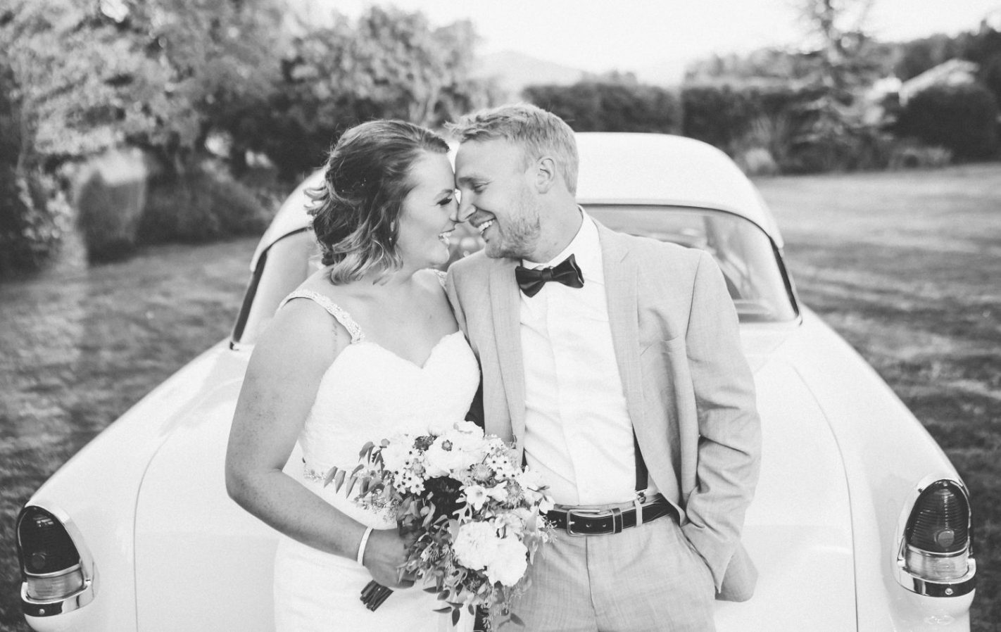 vintage-car-with-bride-groom-classic-black-white