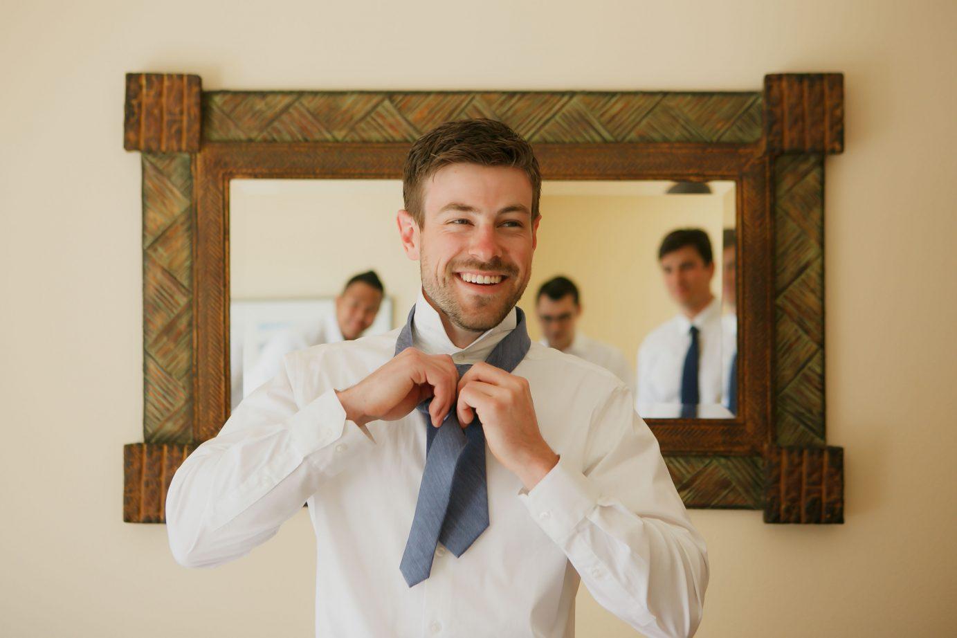 roche-harbor-wedding-groomsmen-groom-tying-tie