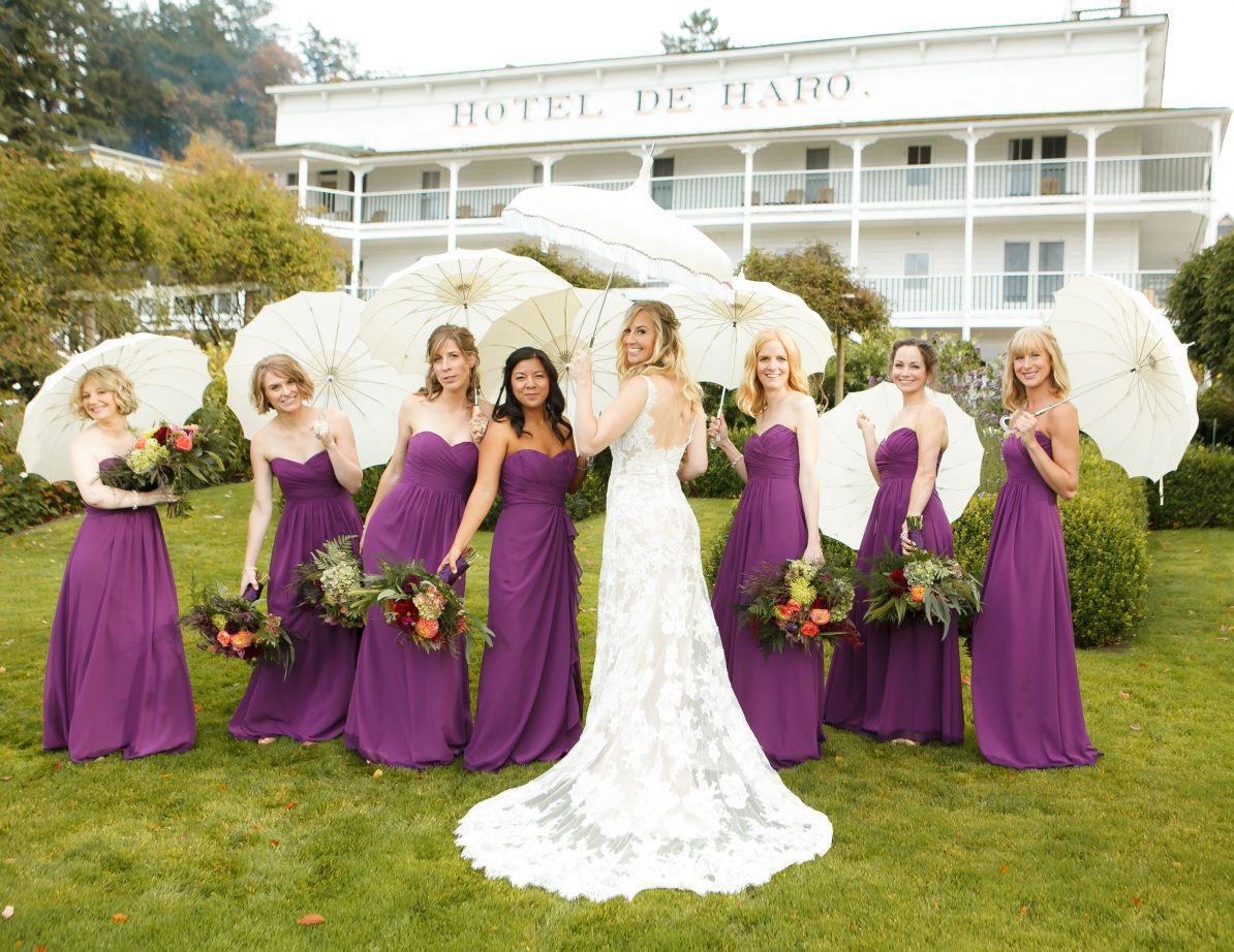 roche-harbor-wedding-hoteldeharo-bridesmaids-parasols-purple-dresses