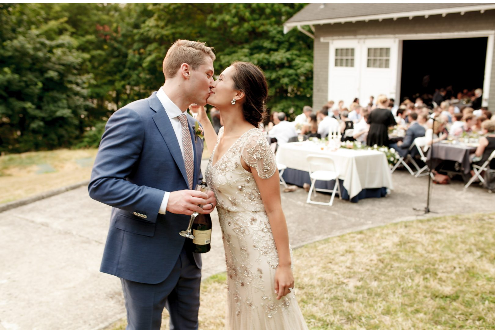 woodstock farm bellingham wedding venue cute couples kissing at wedding reception
