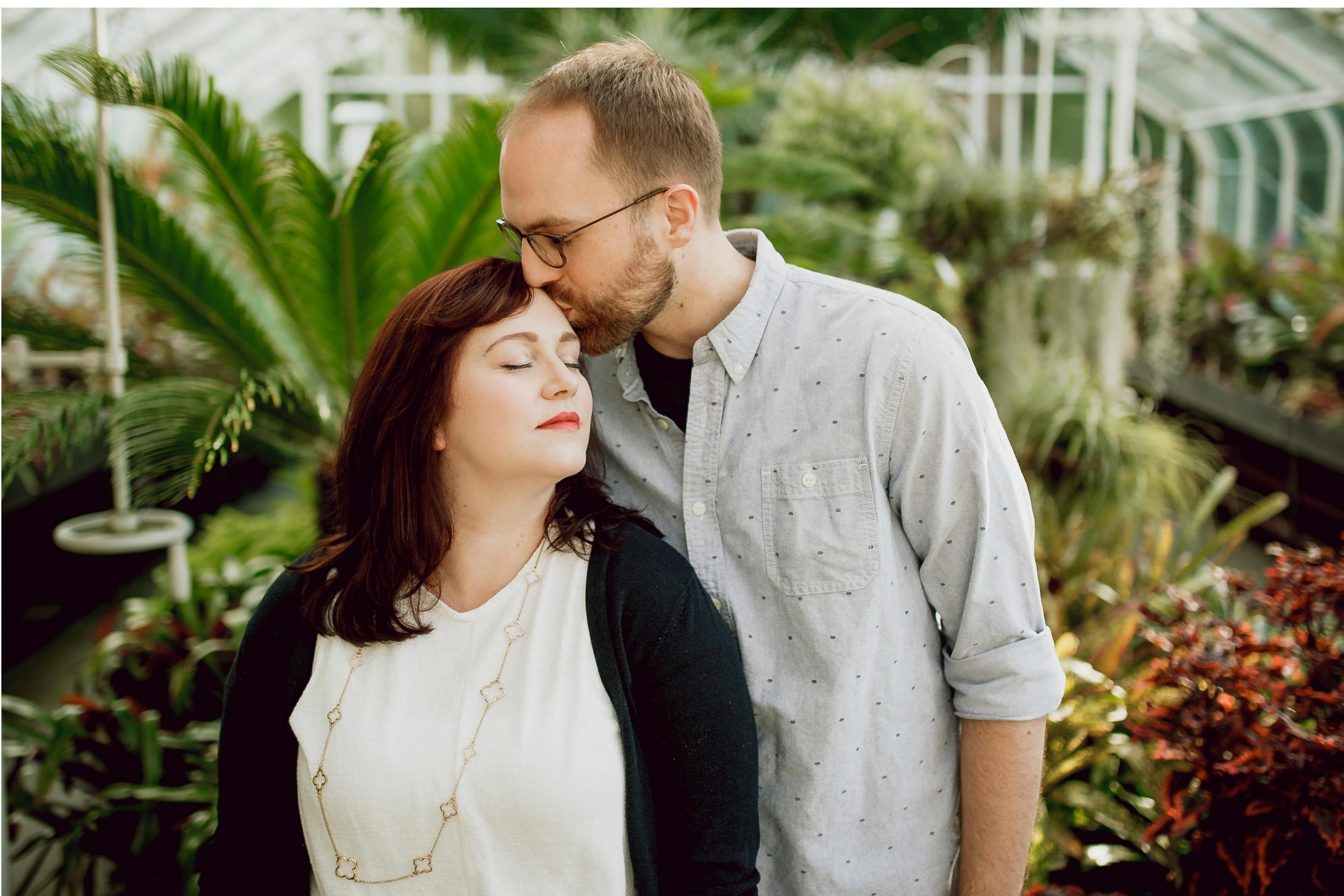 kiss on the forehead seattle engagement photo at conservatory in volunteer park