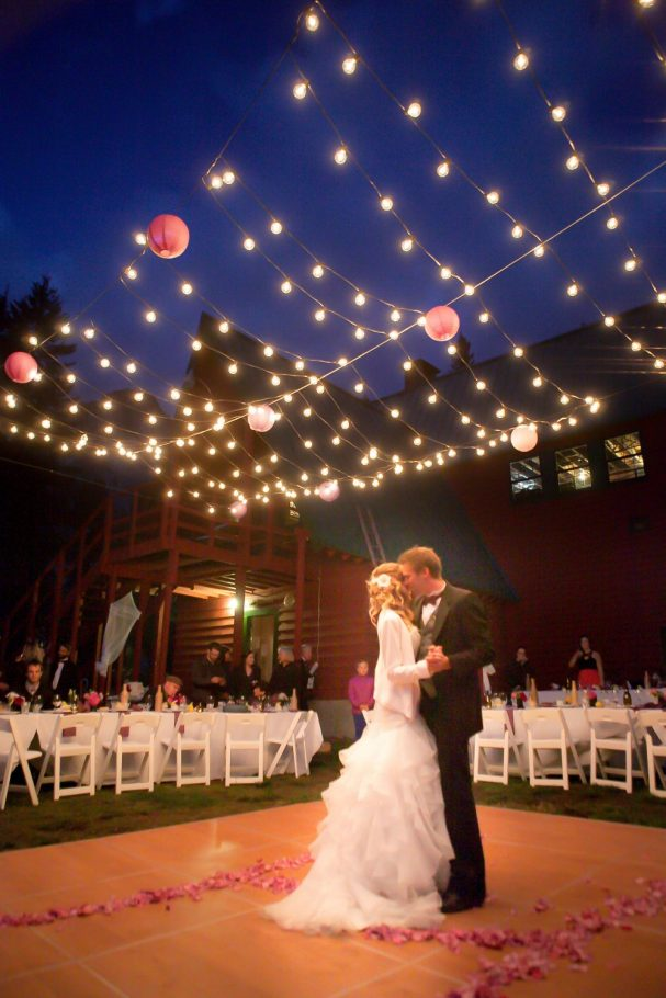 first-dance-bride-groom-globe-lights-romantic