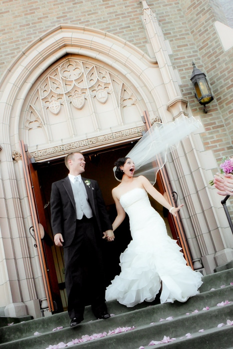 bride and groom in bellingham recessional from church ceremony venue